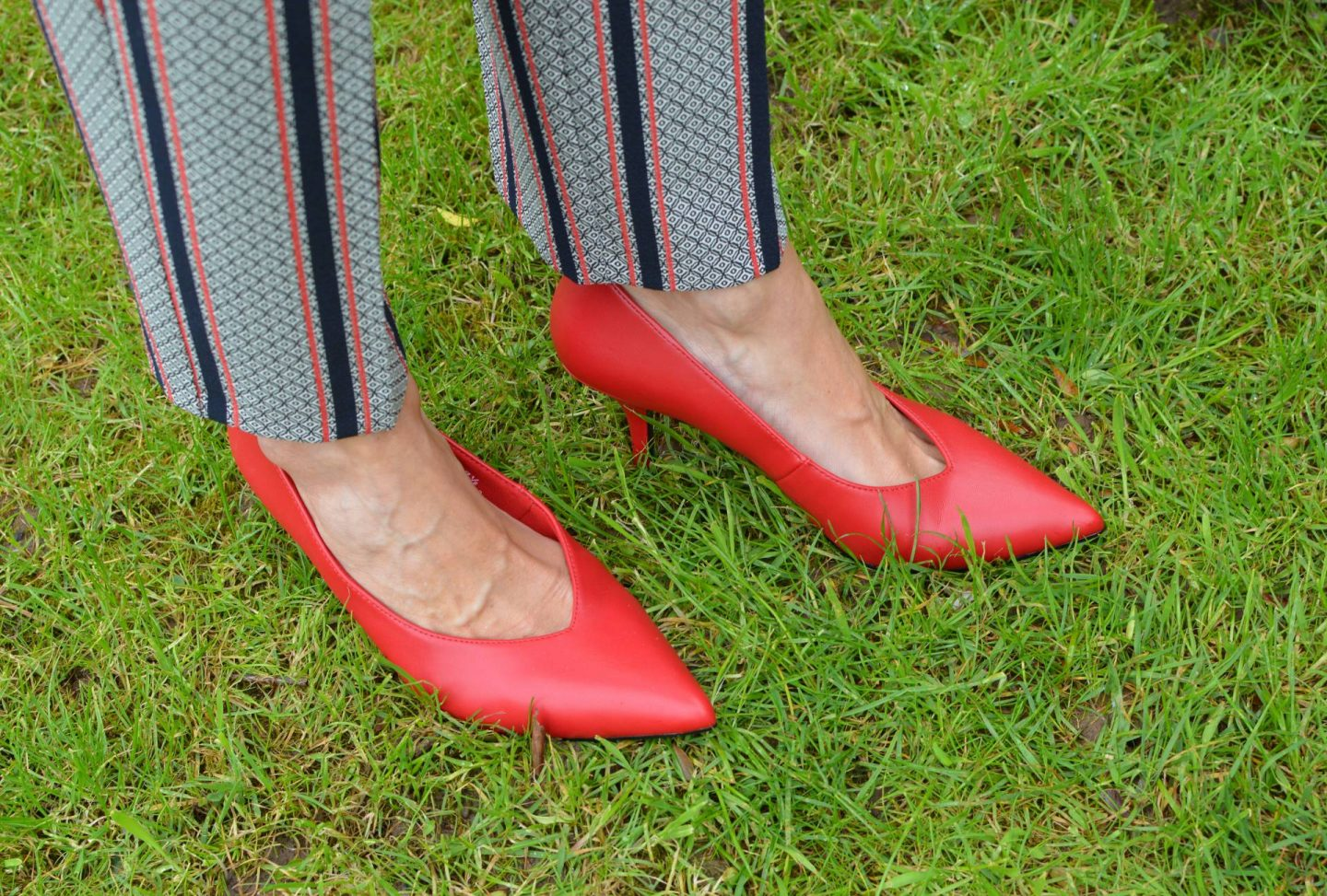 River Island trouser suit, M&S faux leather red court shoes