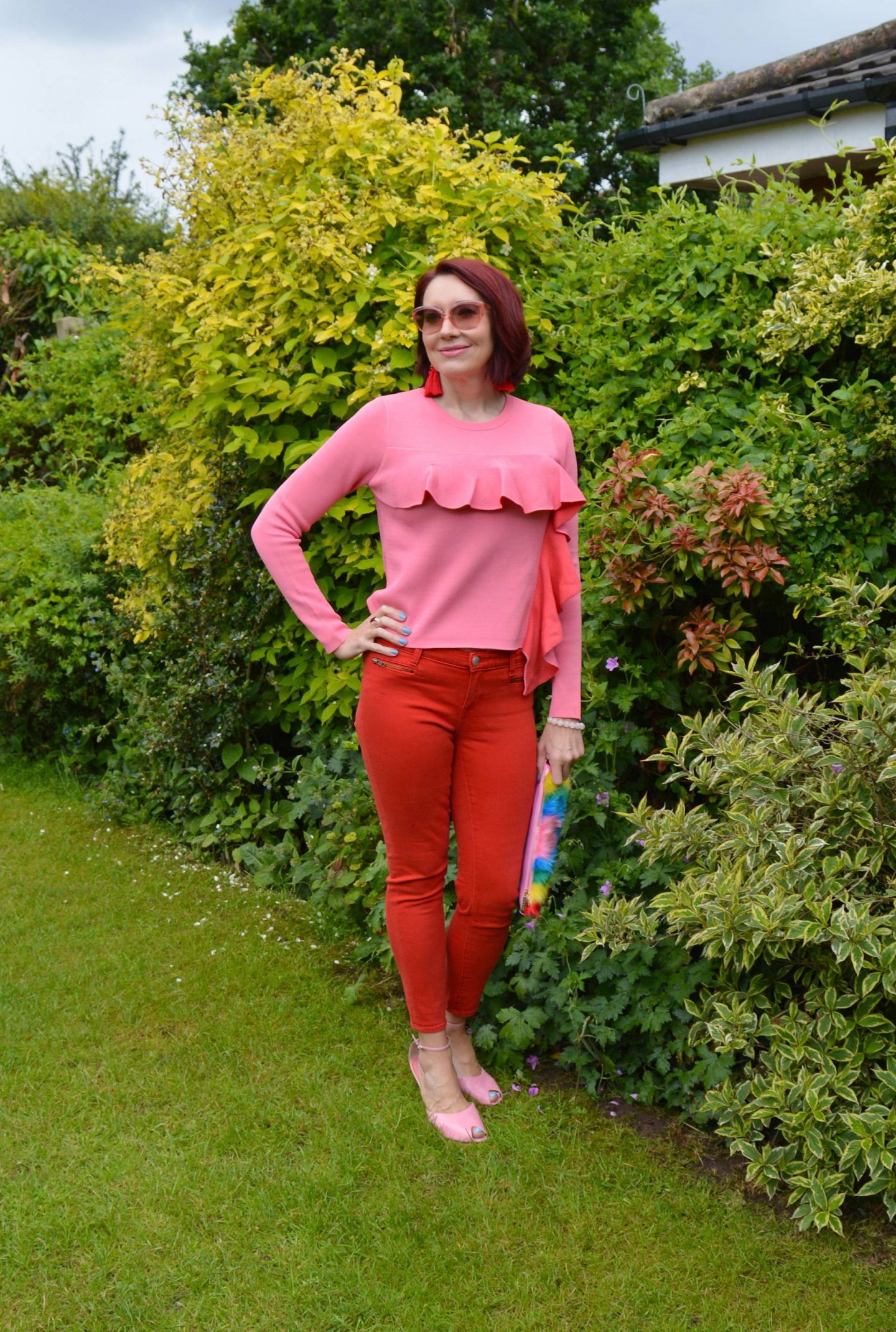 Pink Frills, Red Denim and a Rainbow, Gap red skinny jeans, Skinny Dip rainbow clutch, Asos pink frill sweater