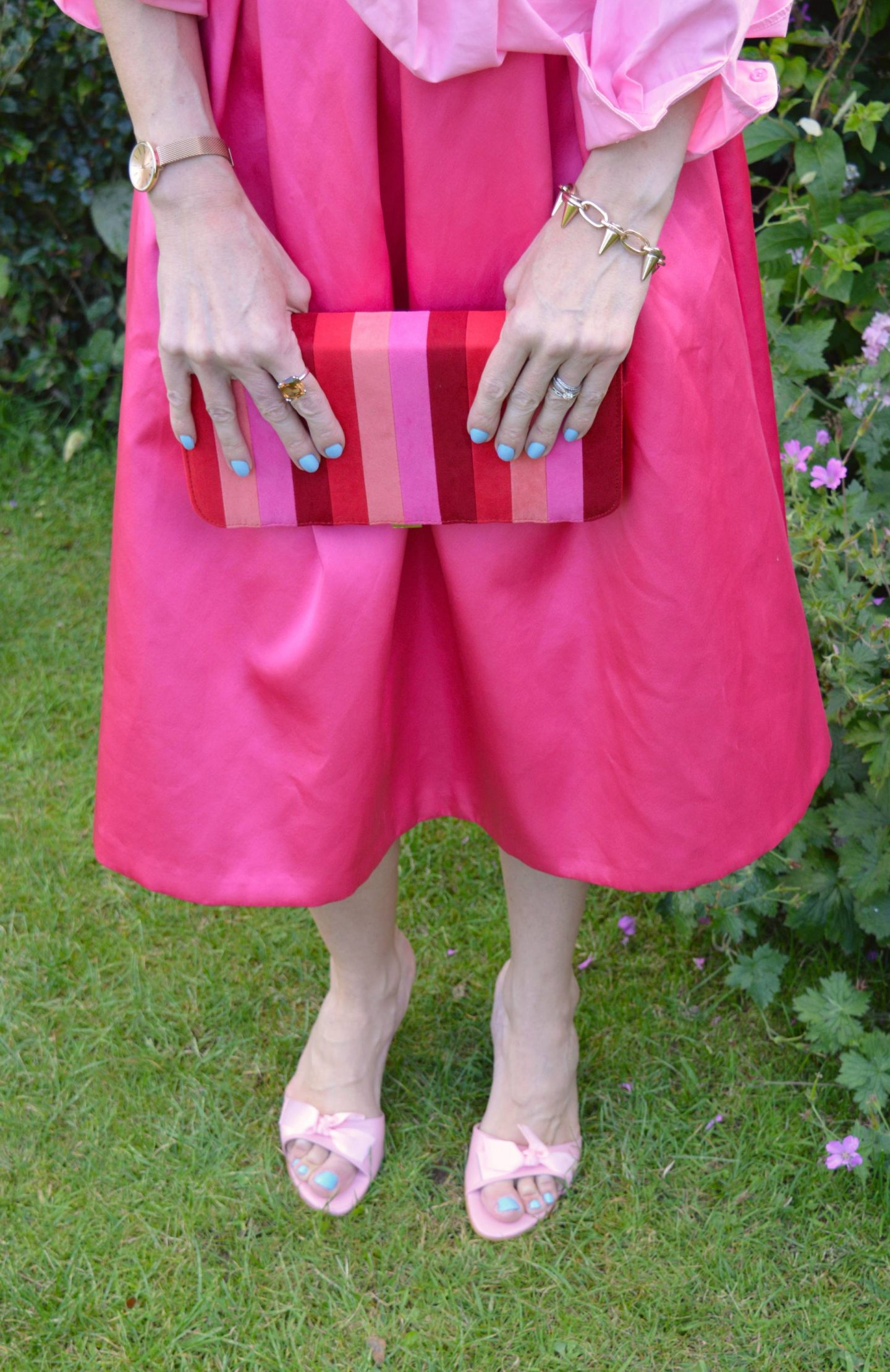 Lotus suedette striped clutch, River Island pink satin skirt