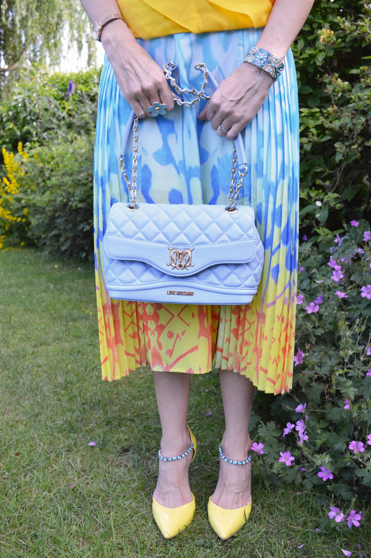 Reiss pleated skirt pale blue Love Moschino bag, Carvela yellow ankle strap shoes