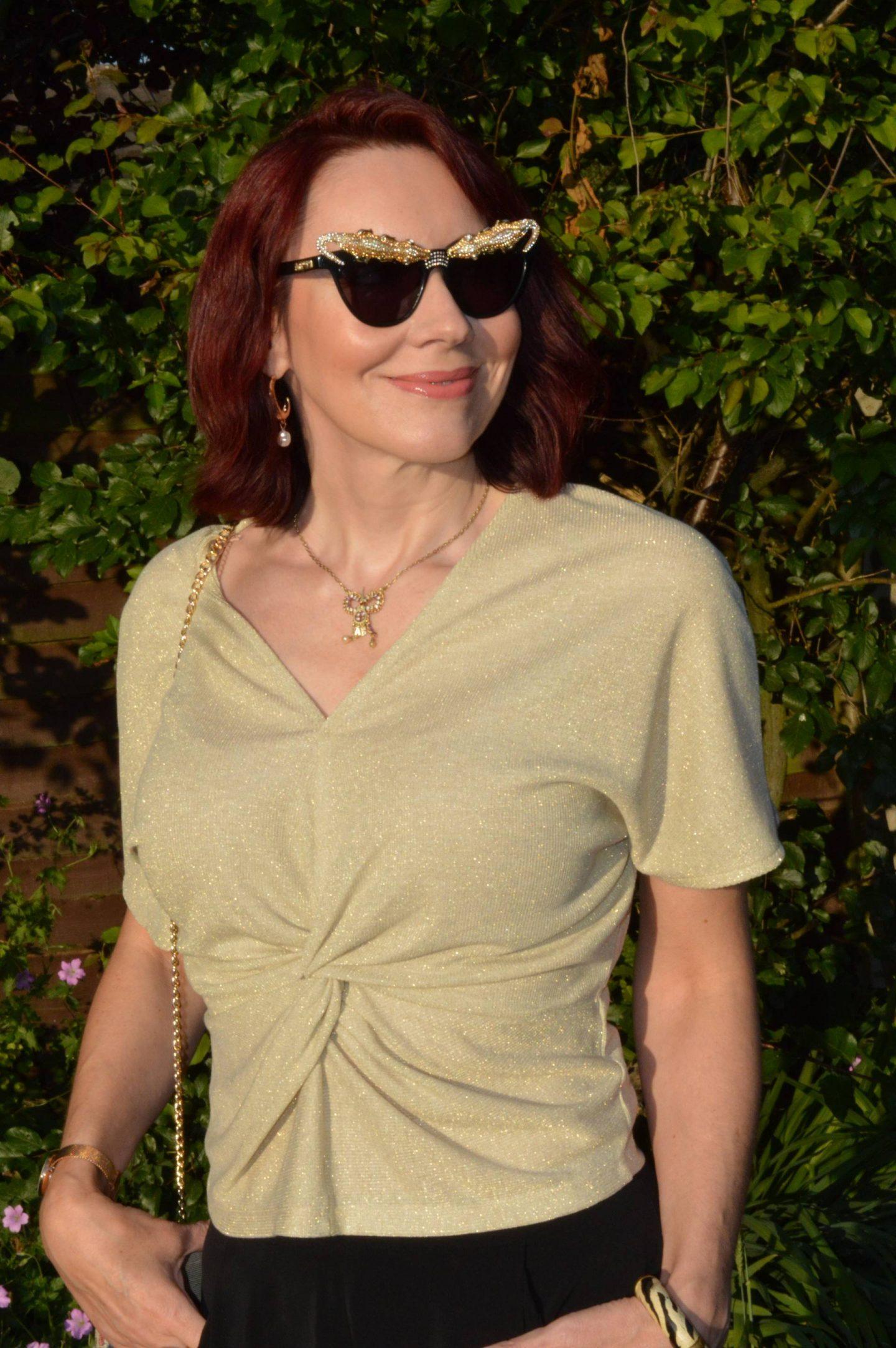 Marks and Spencer gold twist top, Anna Dello Russo H&M lizard sunglasses