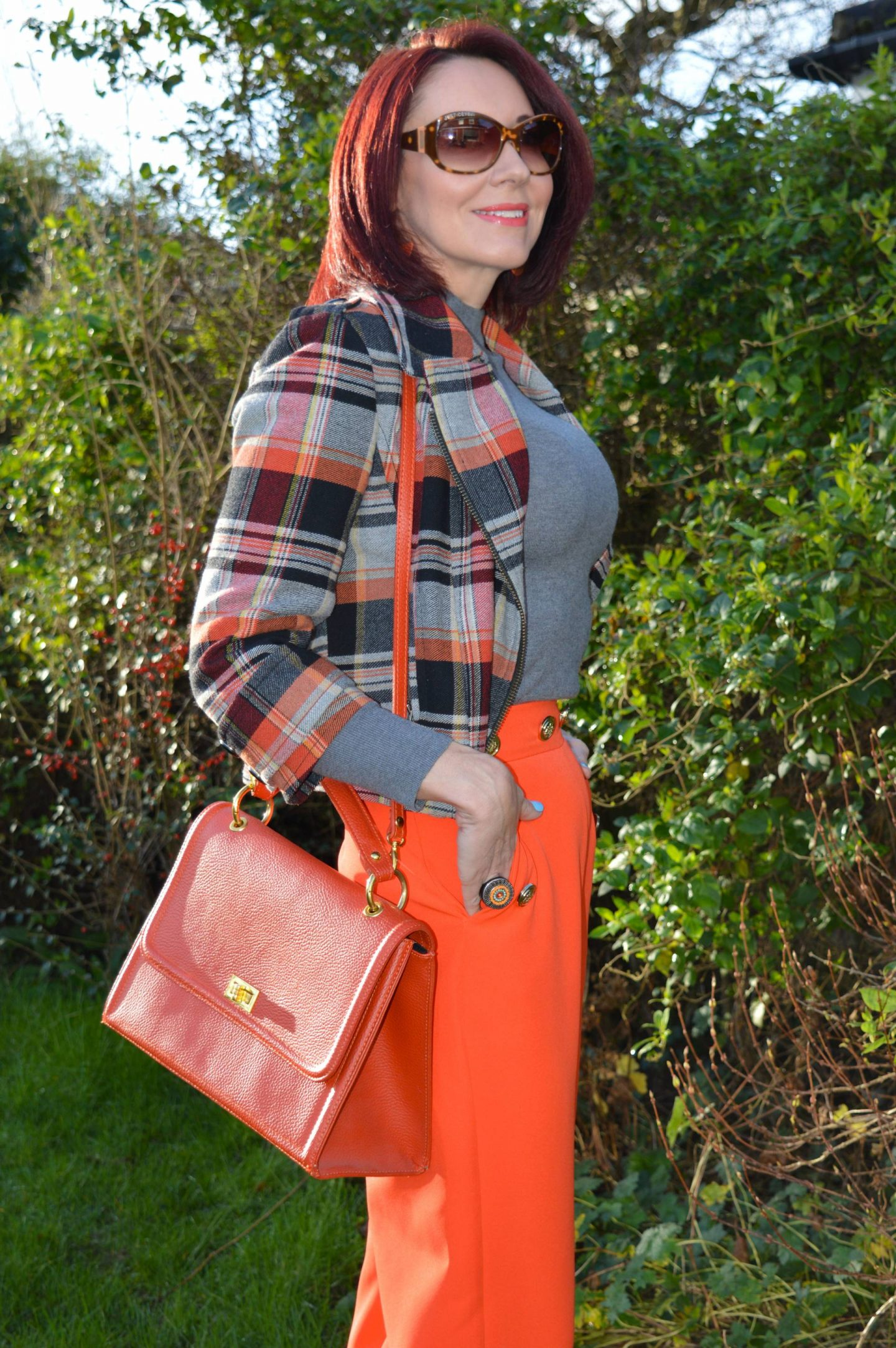 River Island orange trousers, French Connection tartan biker jacket