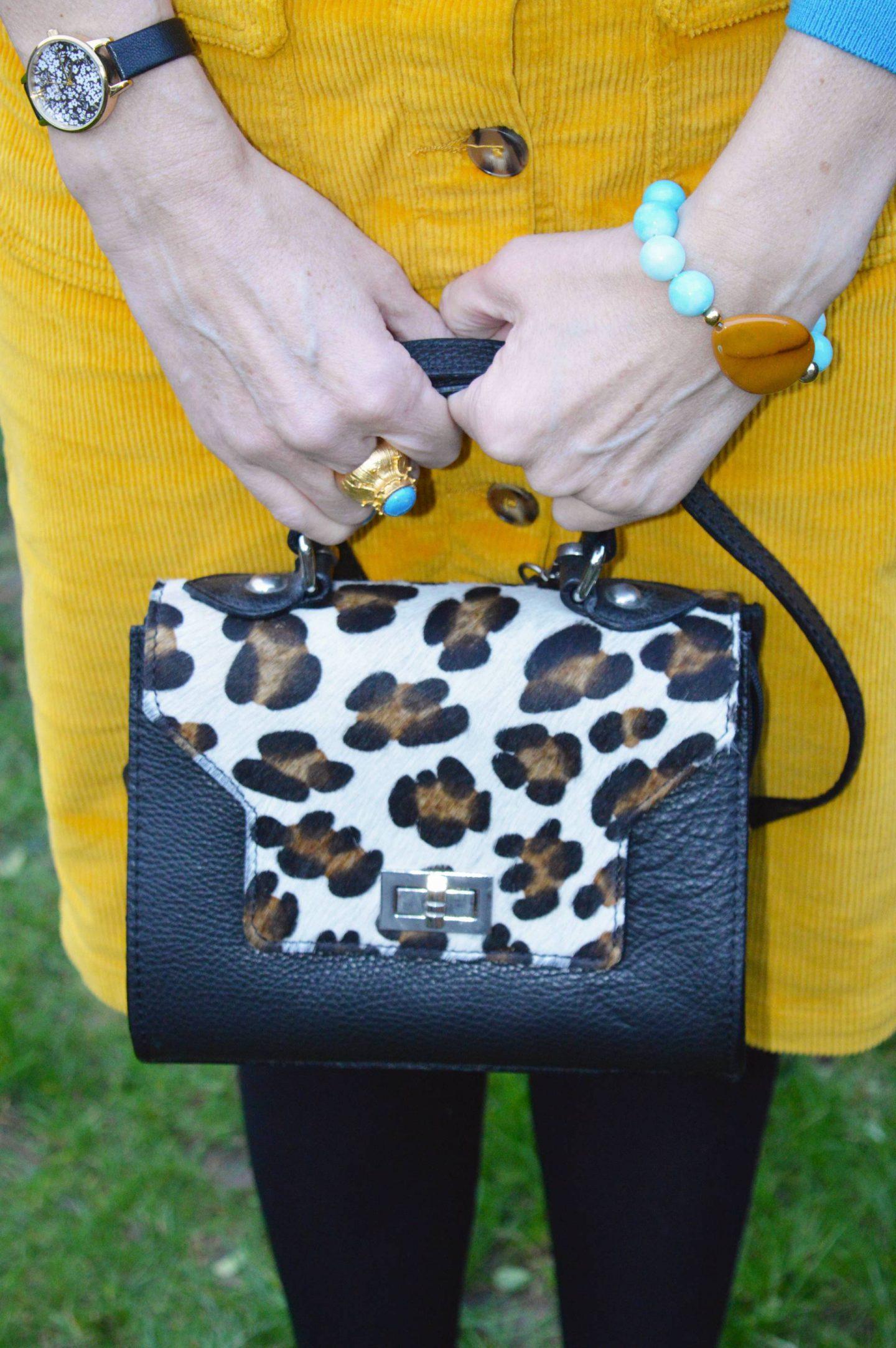 yellow cord skirt, leopard print bag