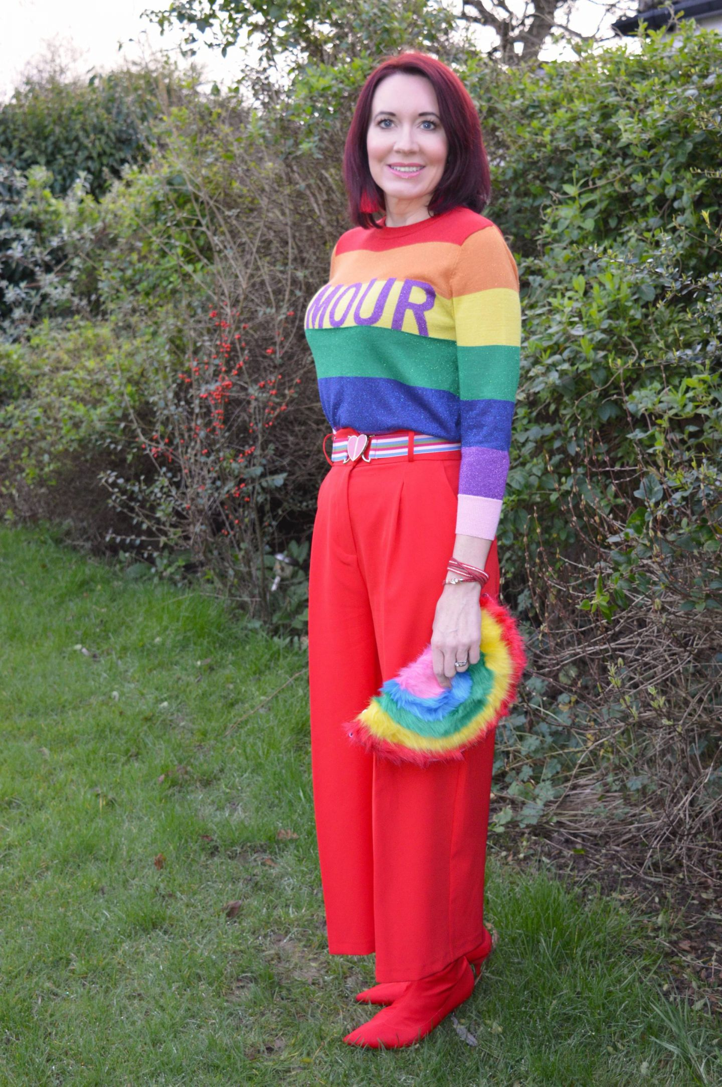 Red for Valentine's Day, Amour logo rainbow sweater, red Asos culottes, Skinny Dip faux fur rainbow clutch