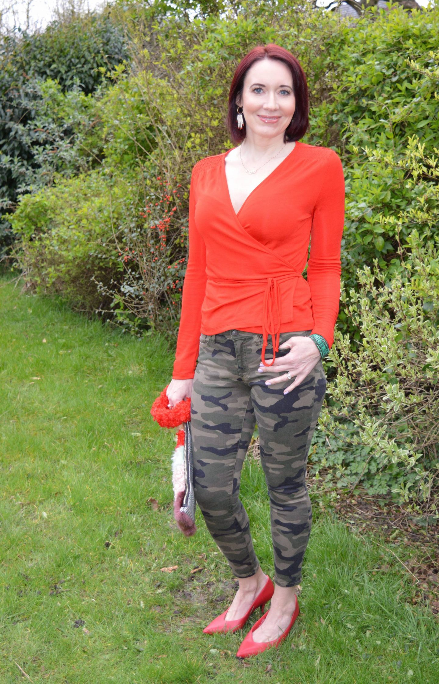 Camo Print Skinny Jeans and Red Wrap Top