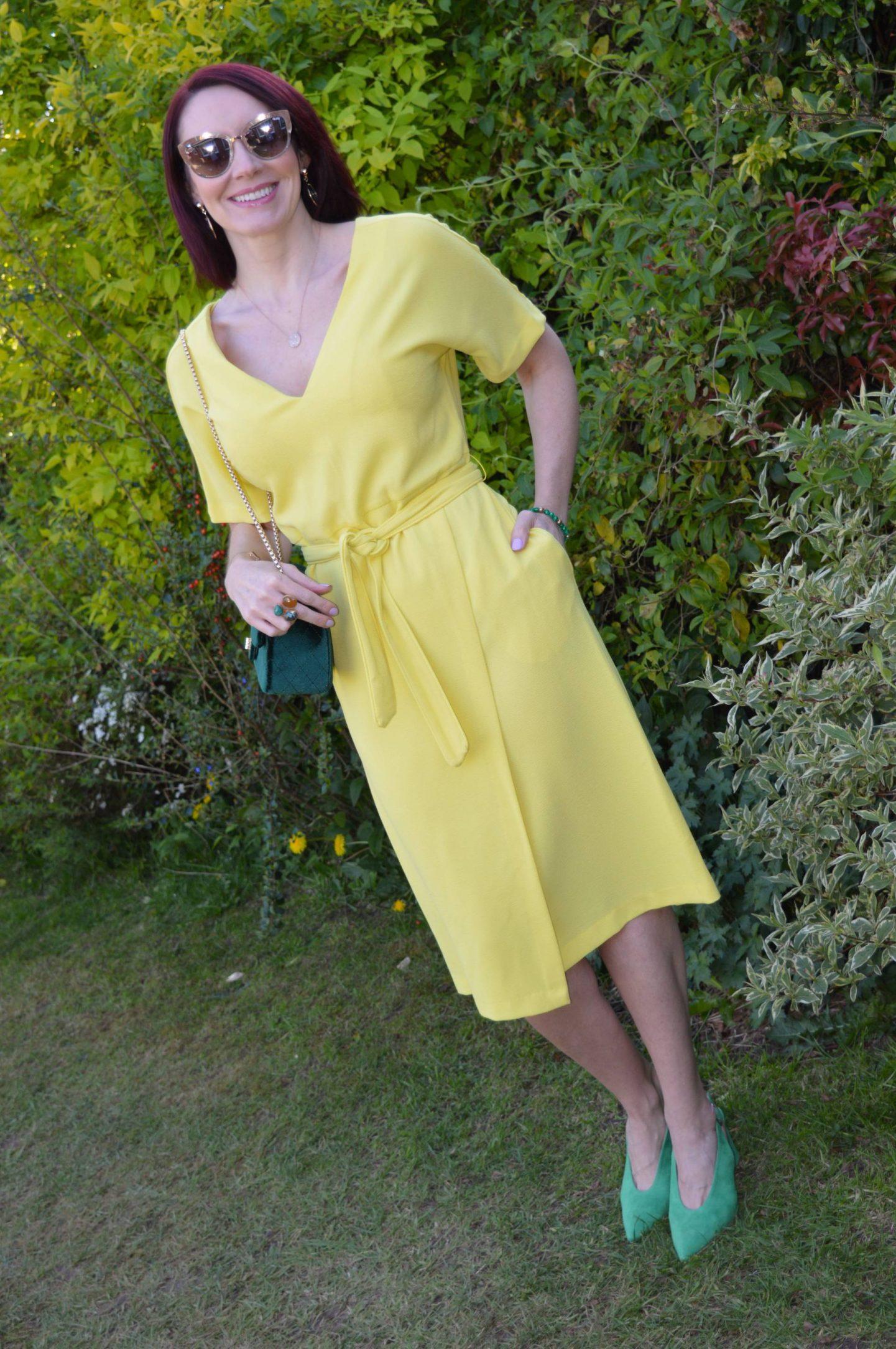 Yellow Belted Midi Dress, green velvet bag, Quay gold sunglasses