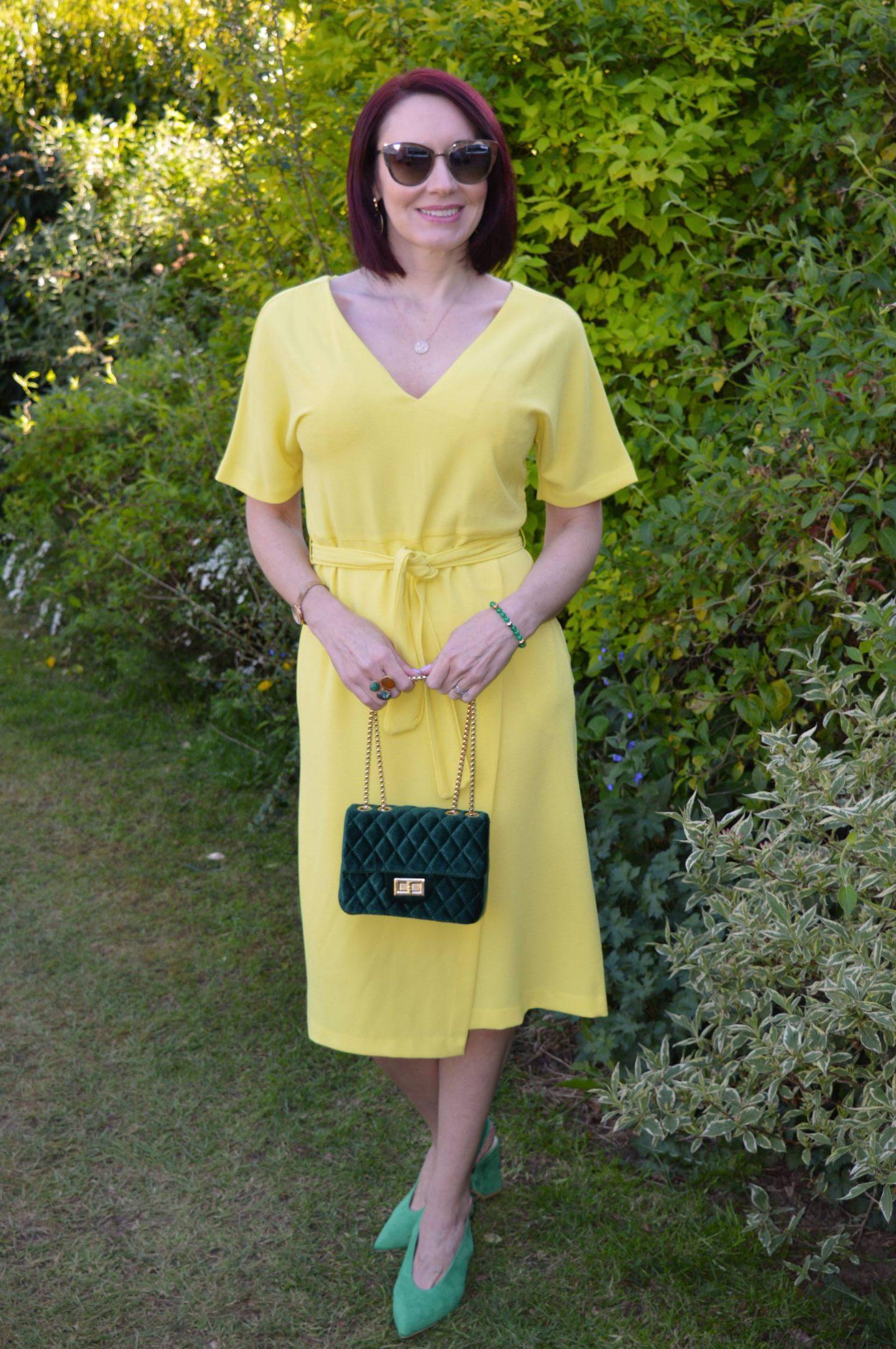 Yellow Marks & Spencer dress, green velvet quilted bag