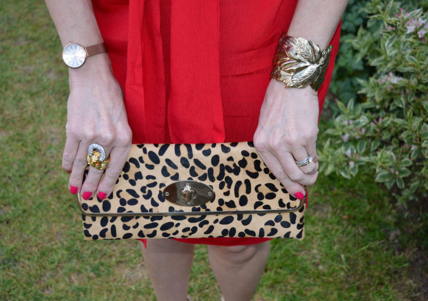 Dune leopard print clutch, Kenneth Jay Lane lion ring