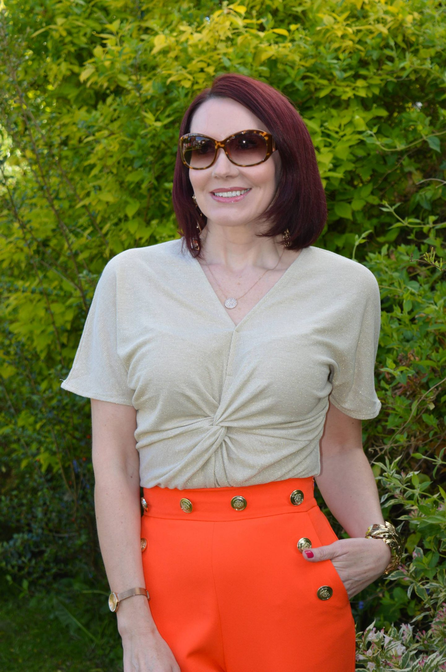 orange River Island trousers, Marks & Spencer gold twist top