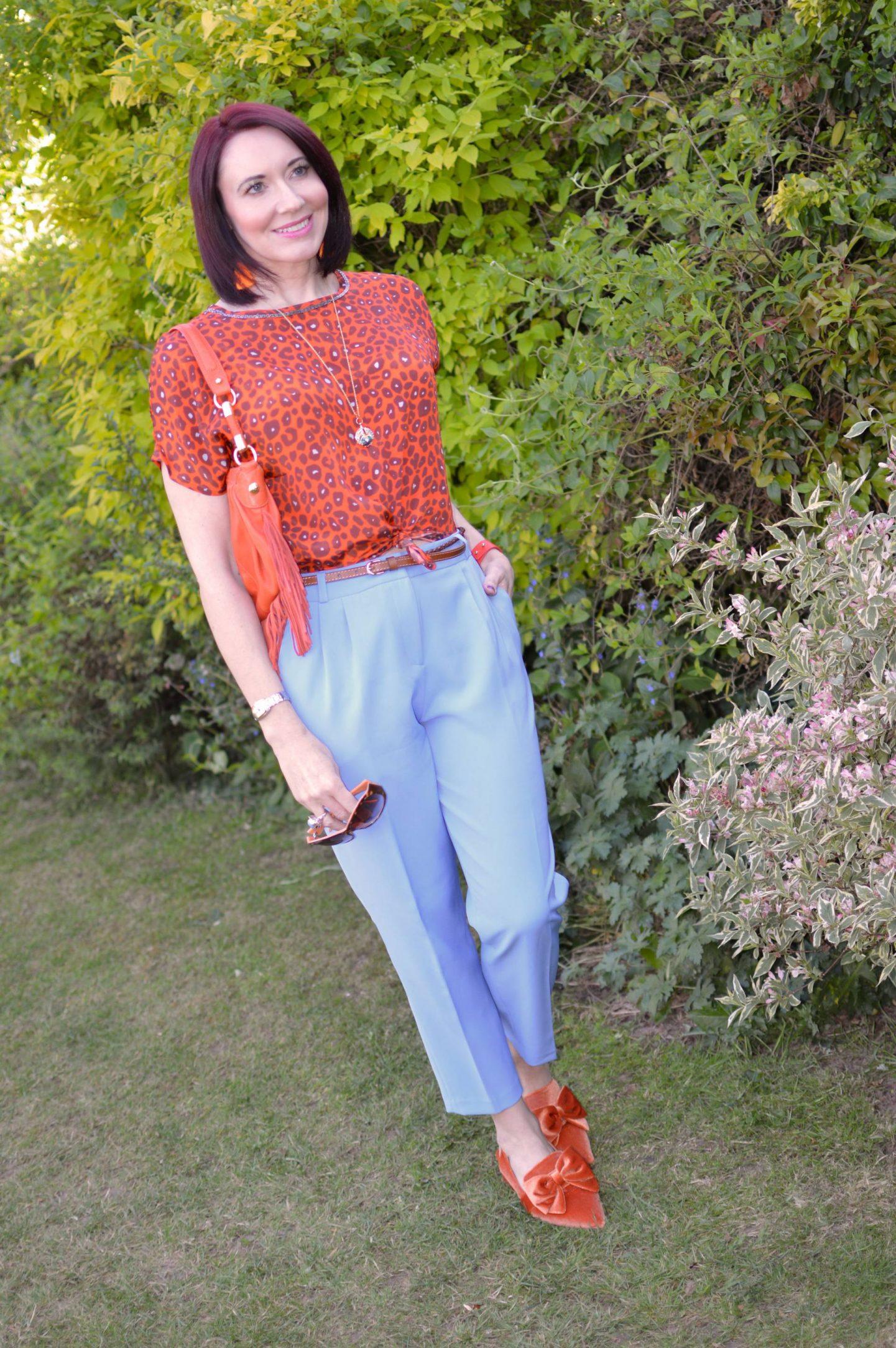 Blue and Bright Orange, Pale blue Asos peg leg trousers, Biba orange leopard print top, Asos orange velvet shoes