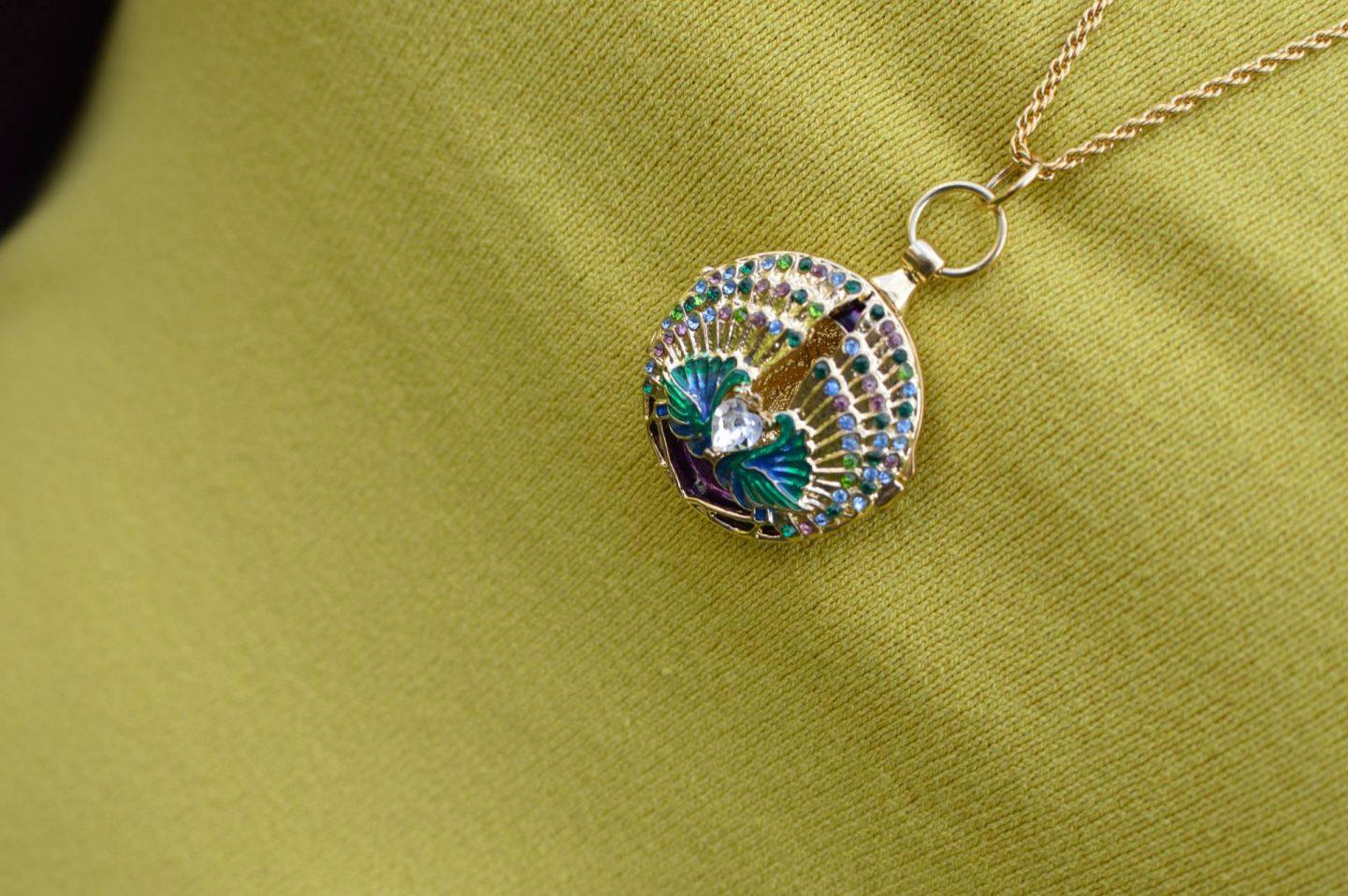 Pia peacock pendant