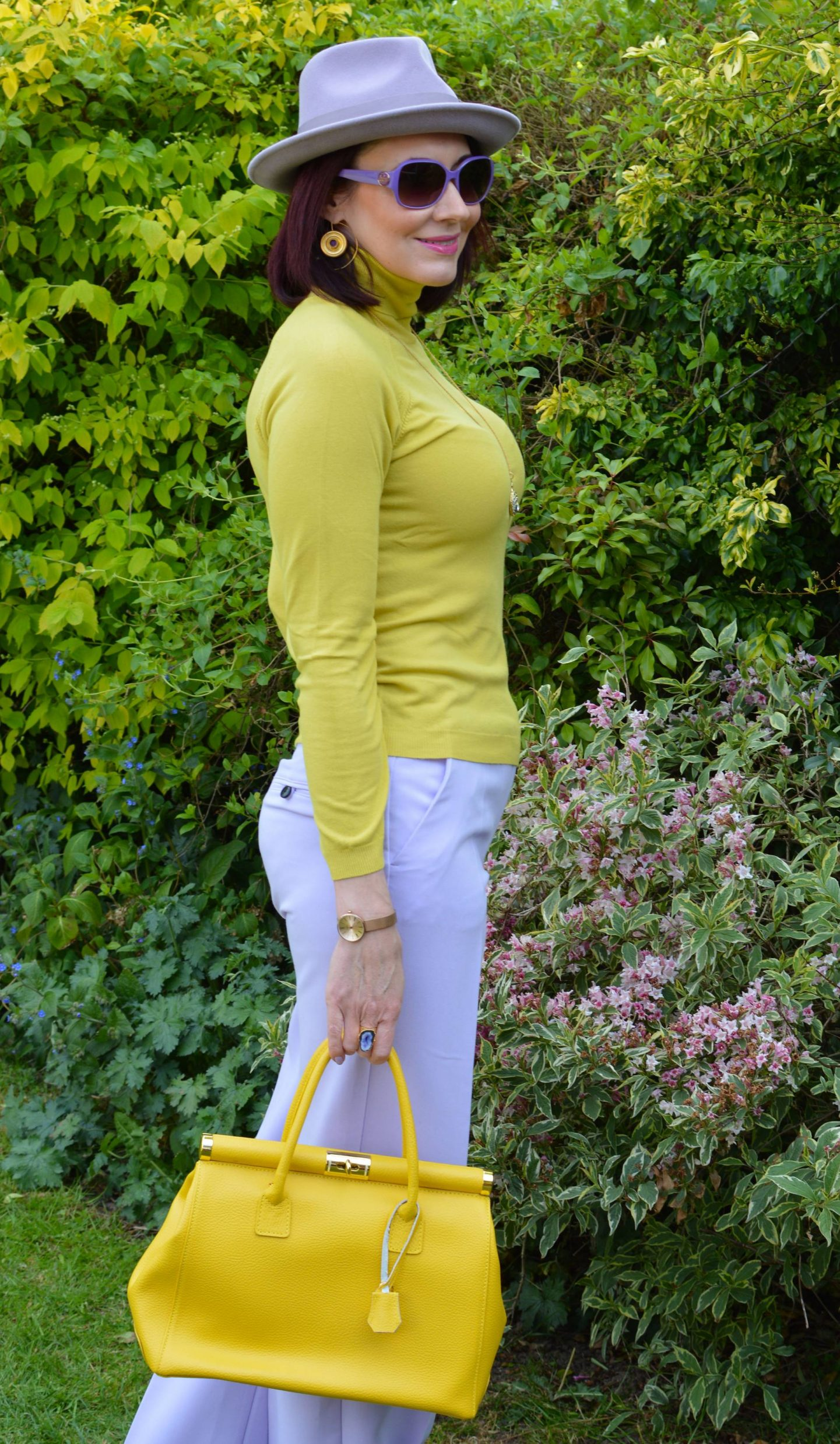 River Island lilac trousers, Anthropologie lilac fedora,  Karen Millen yellow high neck sweater
