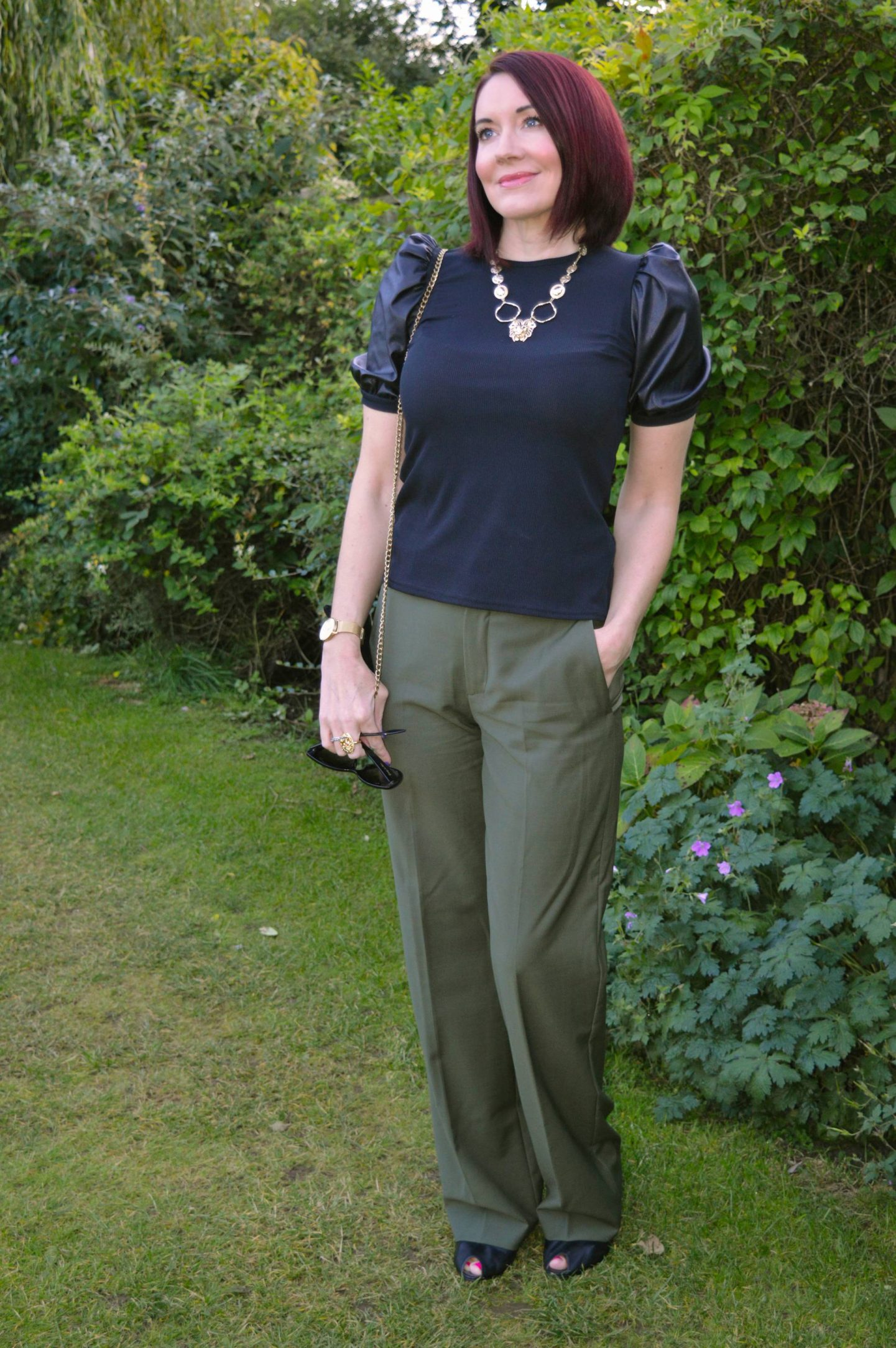 New Look Black Faux Leather Puff Sleeves top and Khaki Trousers,