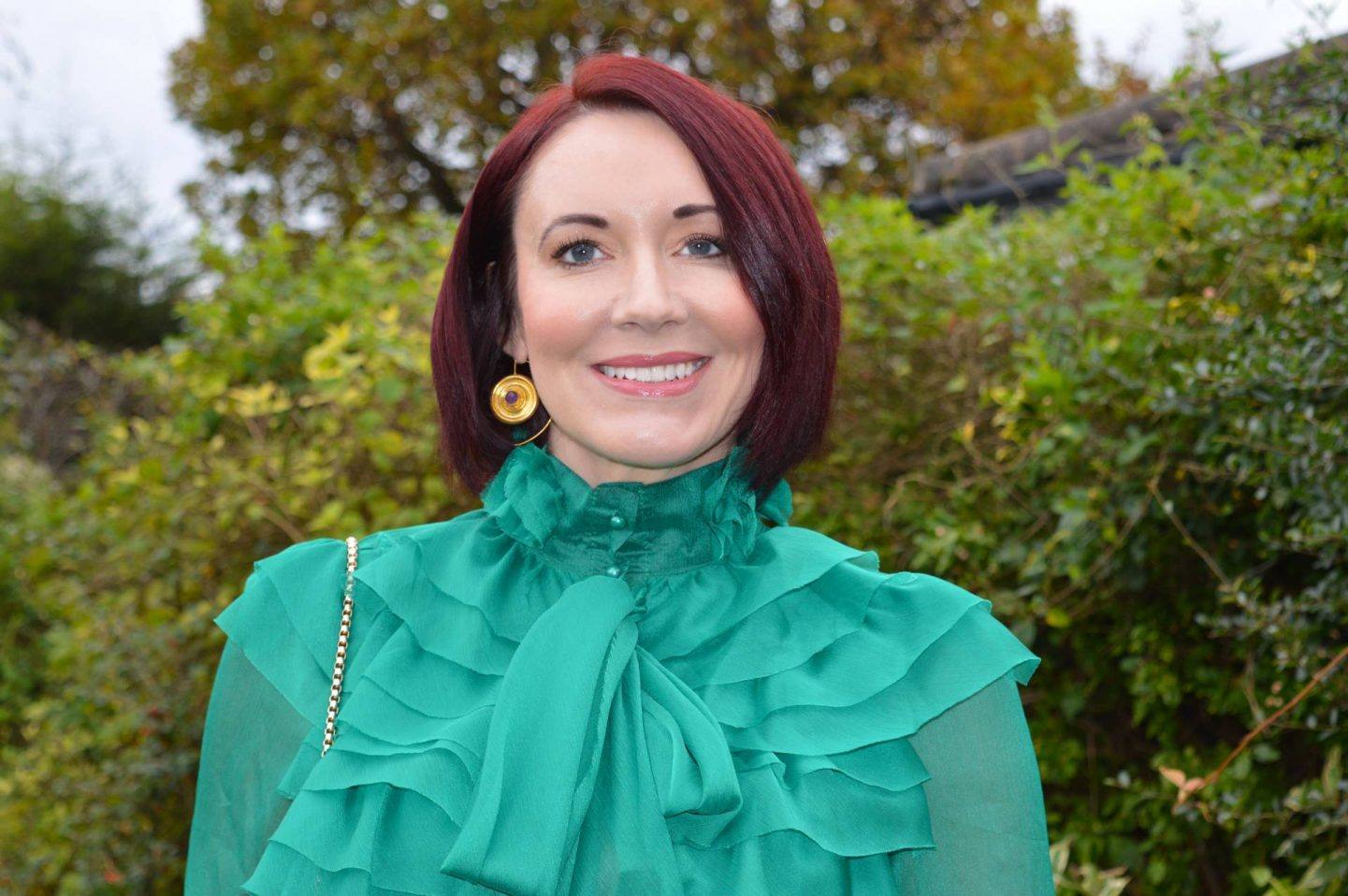 Little Mistress green sheer ruffle blouse, Ottoman Hands gold and amethyst disc earrings