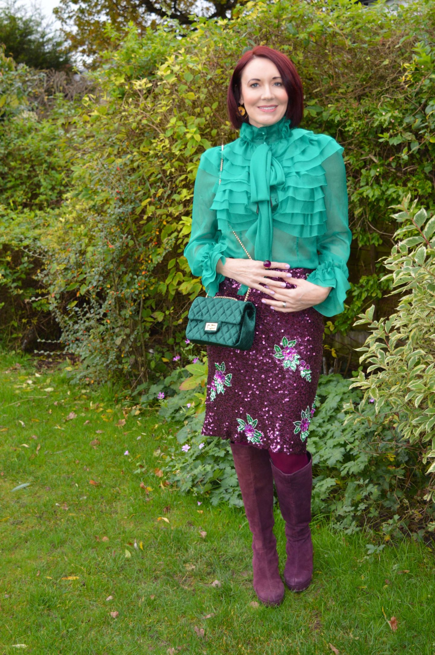 A Touch of Sparkle, Little Mistress green sheer ruffle blouse, Warehouse purple and green sequin skirt, Office burgundy  knee boots