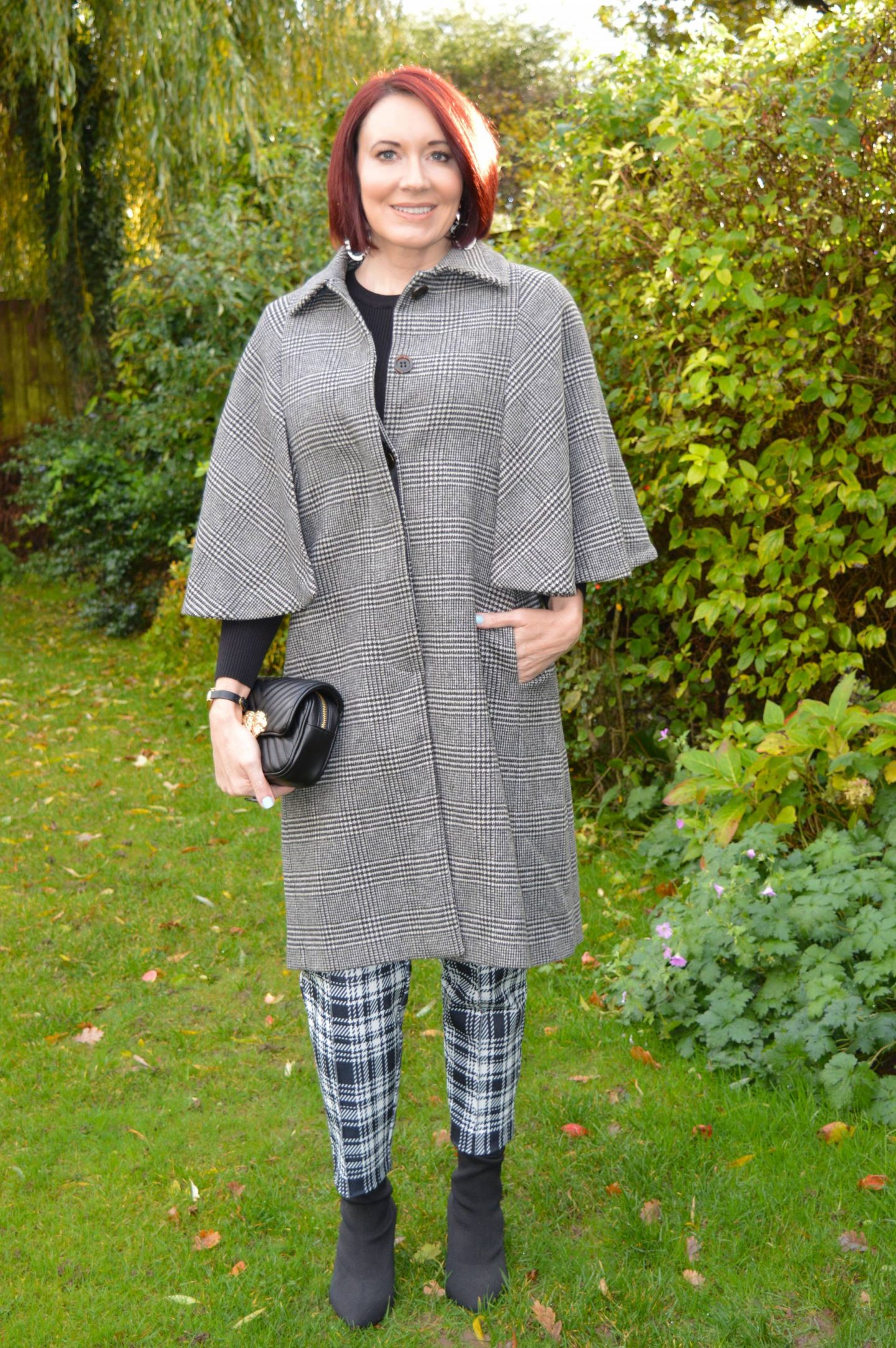 Mixing Double Check Prints, Zara check cape coat, River Island black and white check trousers, Zara black quilted clutch bag
