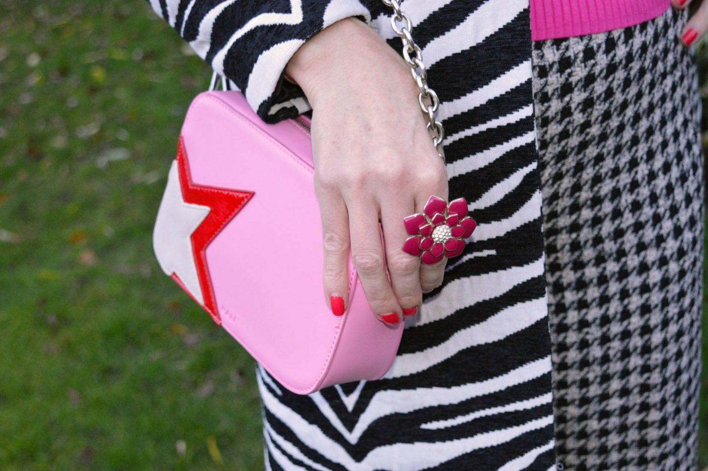 Zara houndstooth trousers, Marks & Spencer pink satin sock boots, pink star motif crossbody bag, pink flower ring