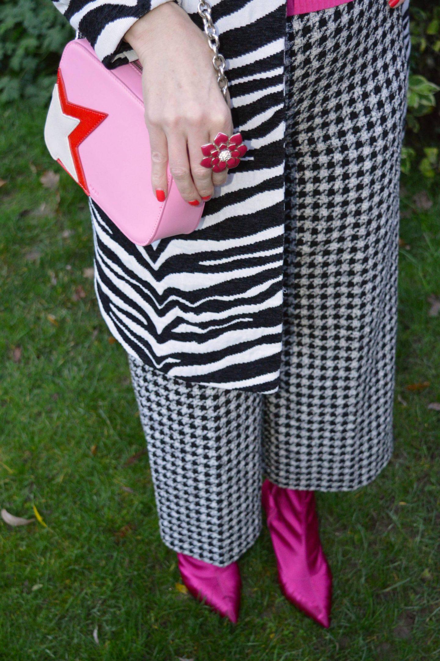 Zara houndstooth trousers, Marks & Spencer pink satin sock boots, pink star motif crossbody bag