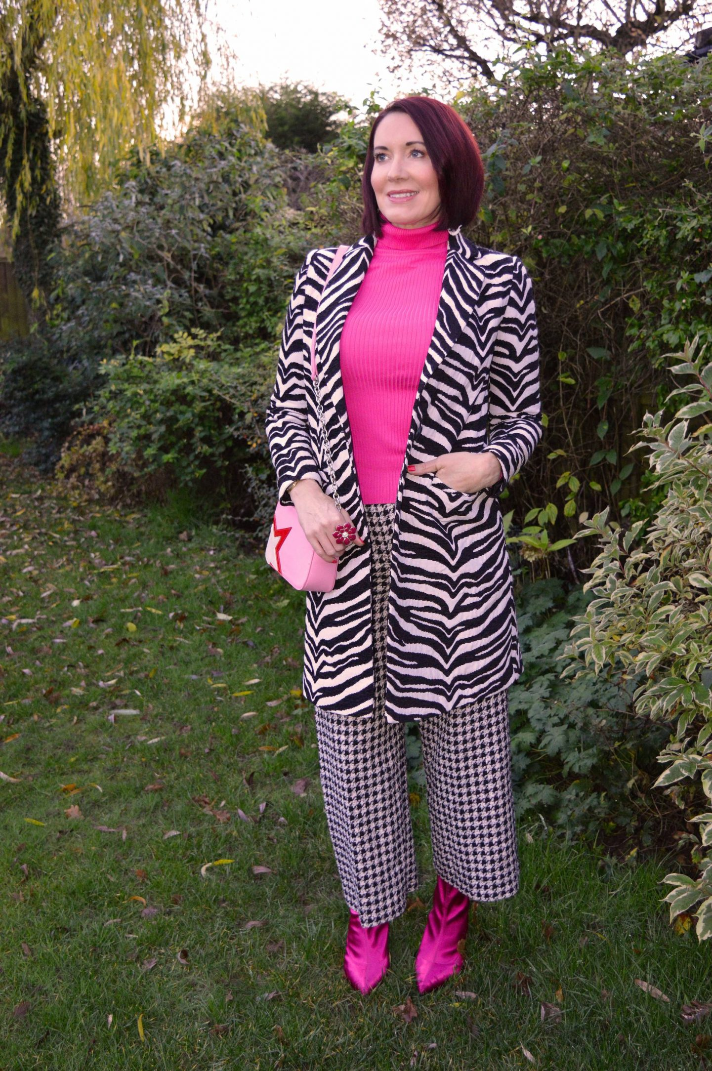 Zebra Print and Houndstooth With Bright Pink, Dept.19 zebra print coat, Zara houndstooth trousers, New Look neon pink ribbed roll neck jumper, Marks & Spencer pink satin sock boots