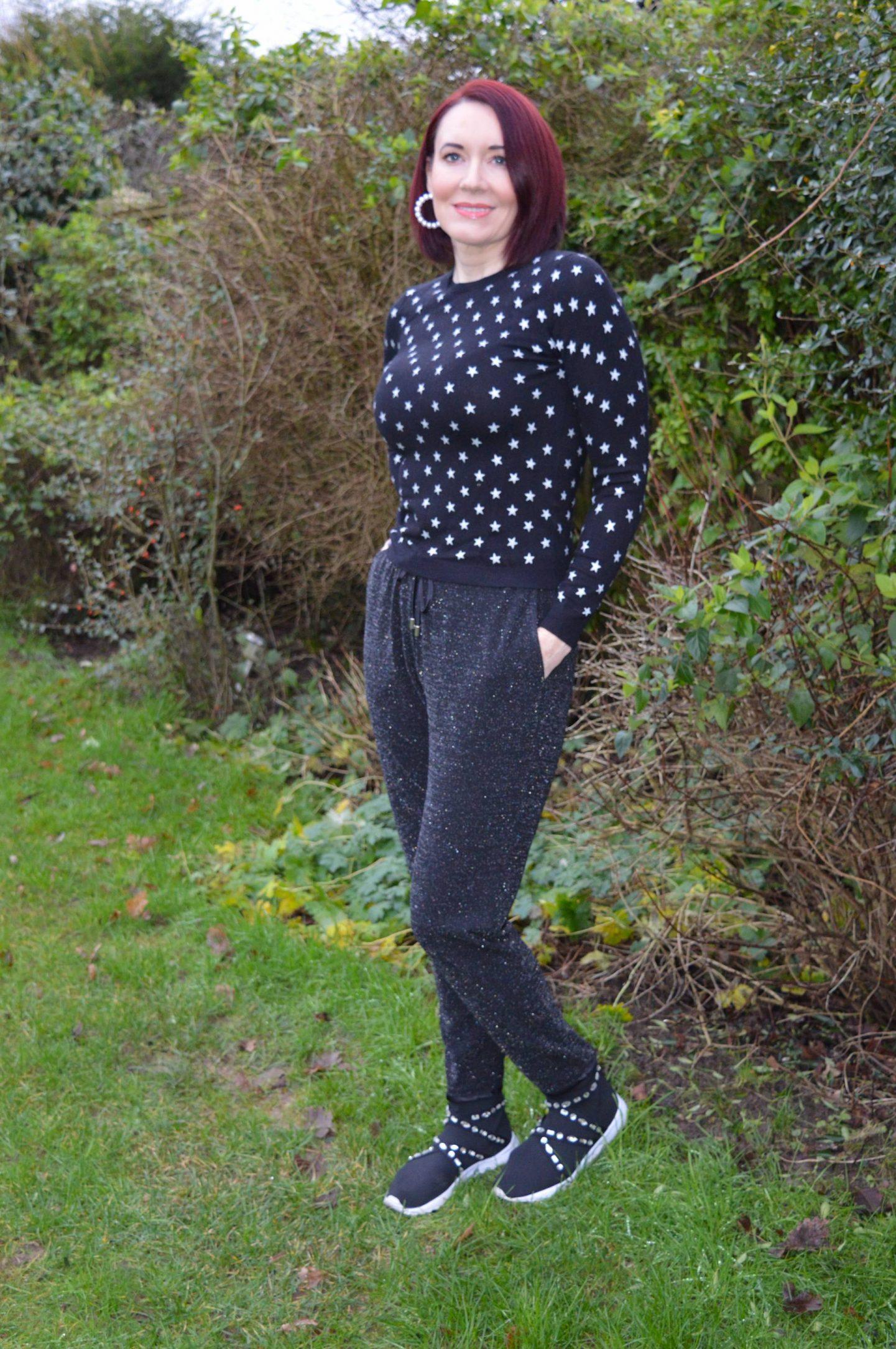 George at Asda black sparkly joggers, Marks & Spencer star print jumper, Asos black embellished sock trainers