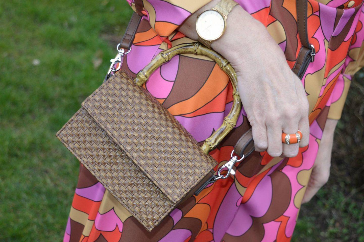 Asos brown woven crossbody bag, Nordgreen gold Philosopher watch