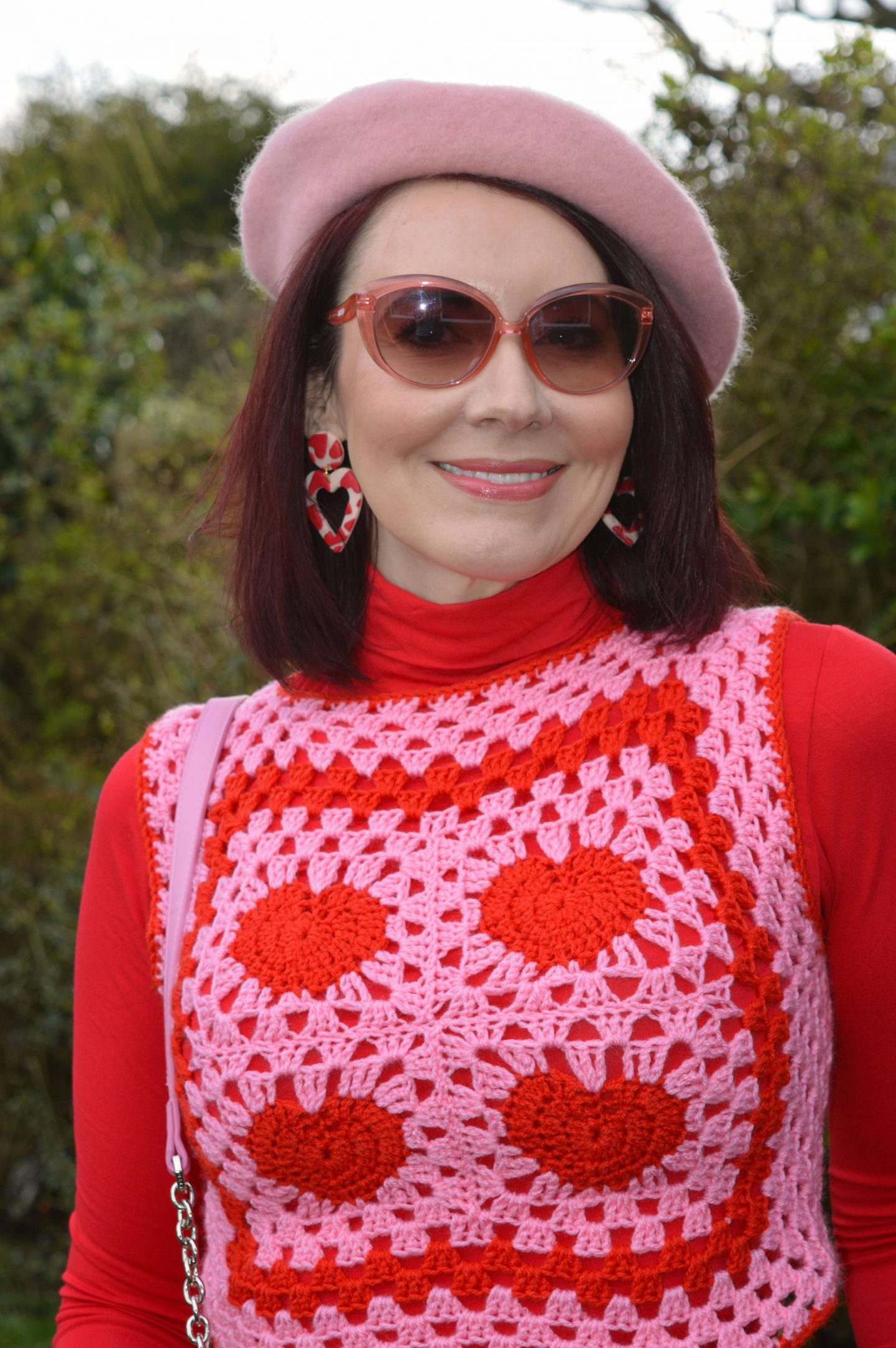 Pink and Bright Red, pink and red heart pattern crocheted vest, Asos pink jewelled beret, Raid red sock boots, pink Moschino cat eye sunglasses