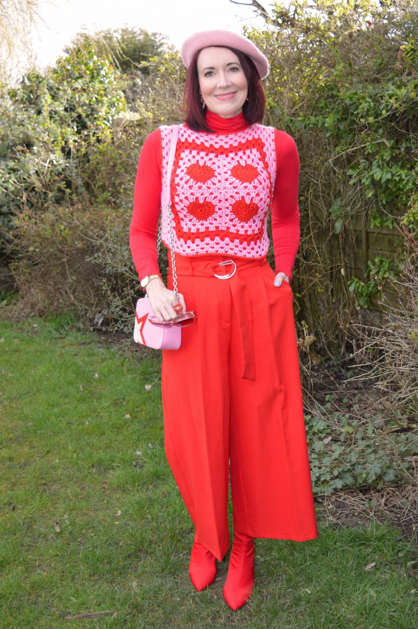 Pink and Bright Red, pink and red heart pattern crocheted vest, Asos red culottes, Asos pink jewelled beret, Raid red sock boots