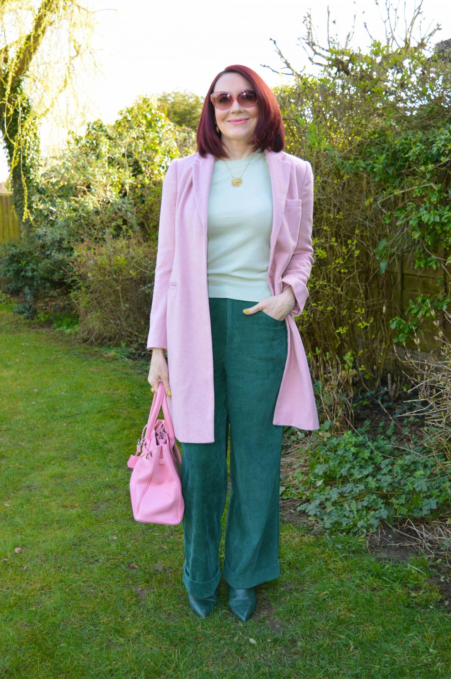 Green and Pastel Pink, Coast forest cord trousers, mint green sheer sleeve top, Great Plains pink coat, Asos dark green boots, J by Jasper Conran pink tote bag