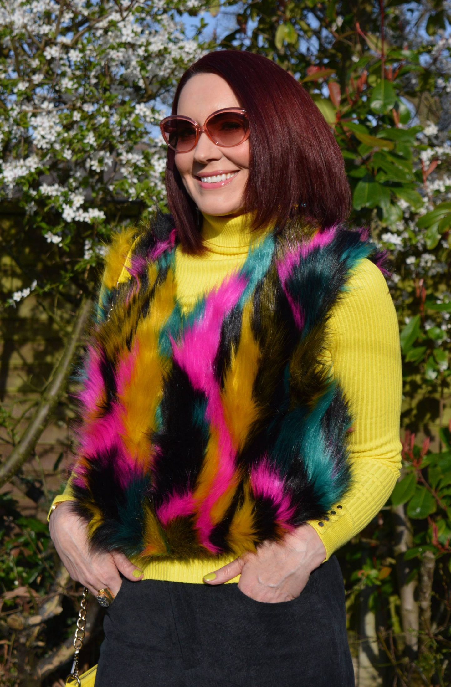 Multicoloured Faux Fur Gilet, yellow ribbed roll neck jumper