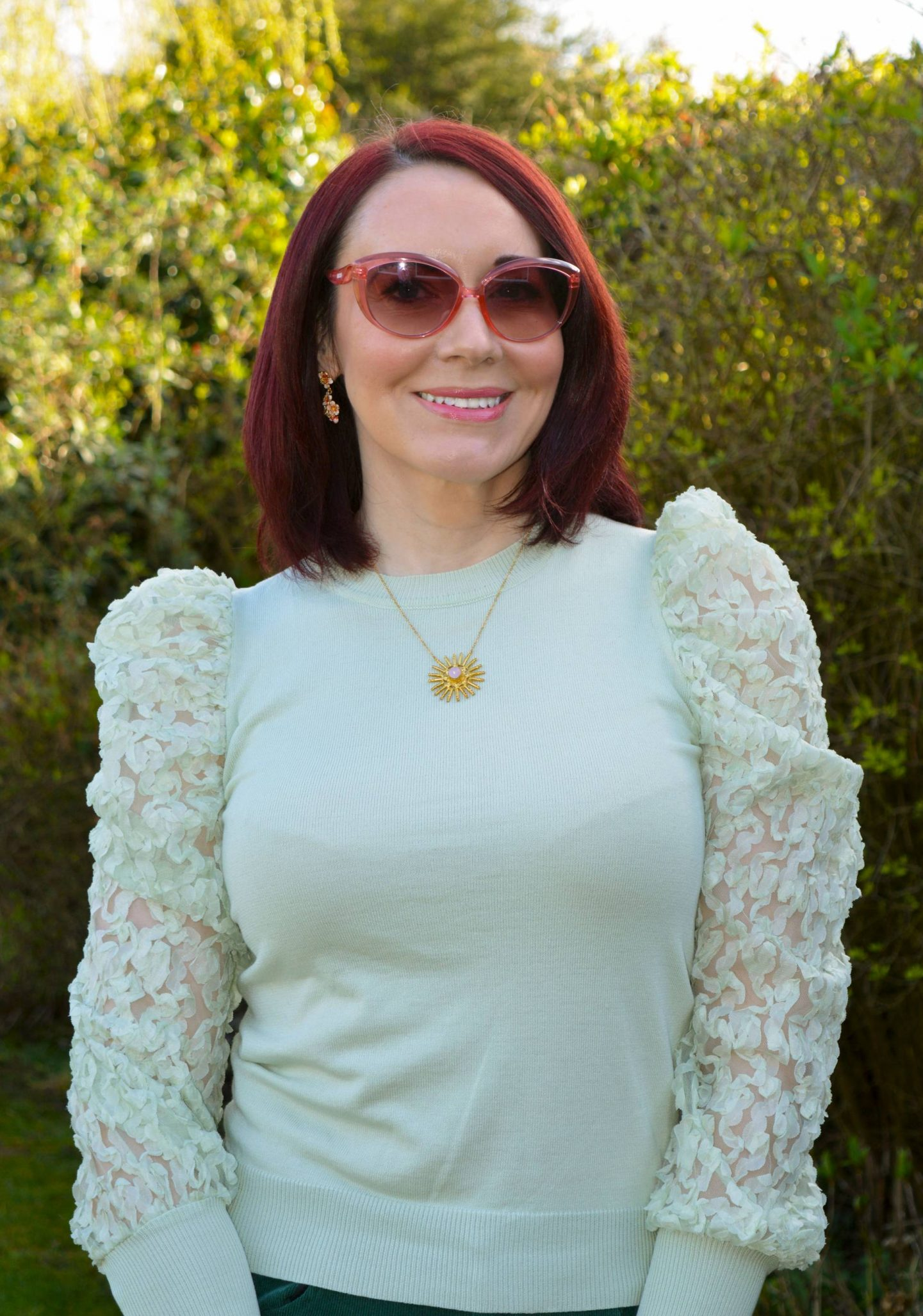 Green and Pastel Pink, mint green sheer sleeve top, Moschino pink sunglasses, Ottoman Hands rose quartz necklace