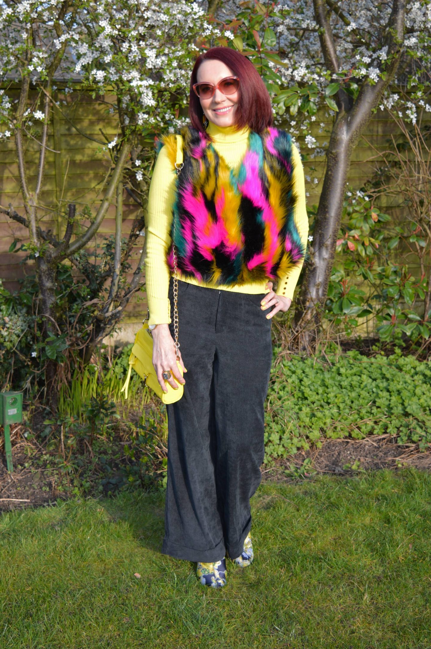 Multicoloured Faux Fur Gilet, yellow ribbed roll neck jumper, Coast baby cord black trousers