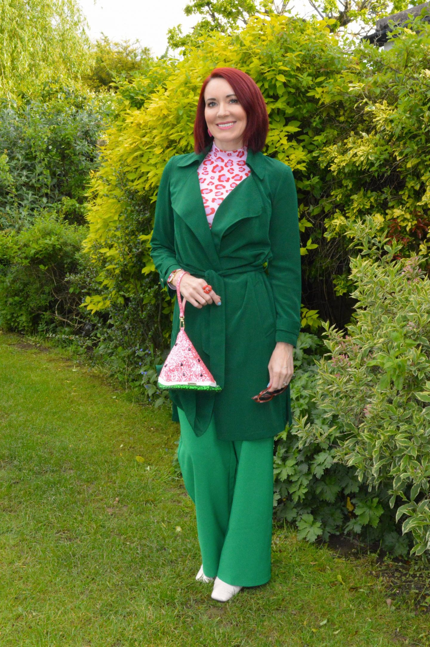 Green and Pink Animal Print, Saturday by Megan Ellaby Hazel pink animal print top, Skinny Dip glitter warermelon bag, Flounce emerald green trousers, Papaya green trench coat