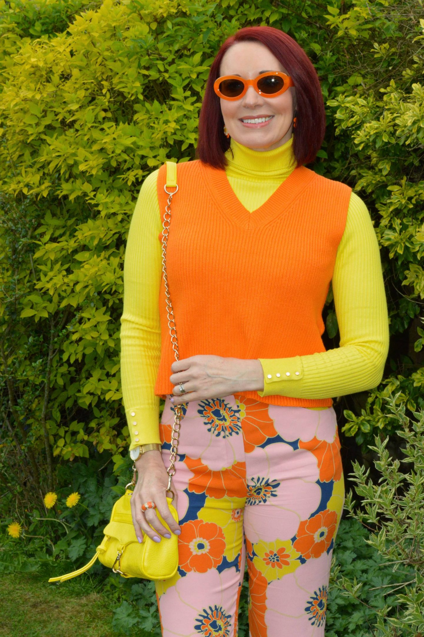 Zara Floral Print Trousers, Zara orange knitted vest, New Look yellow ribbed jumper, Zara orange frame sunglasses