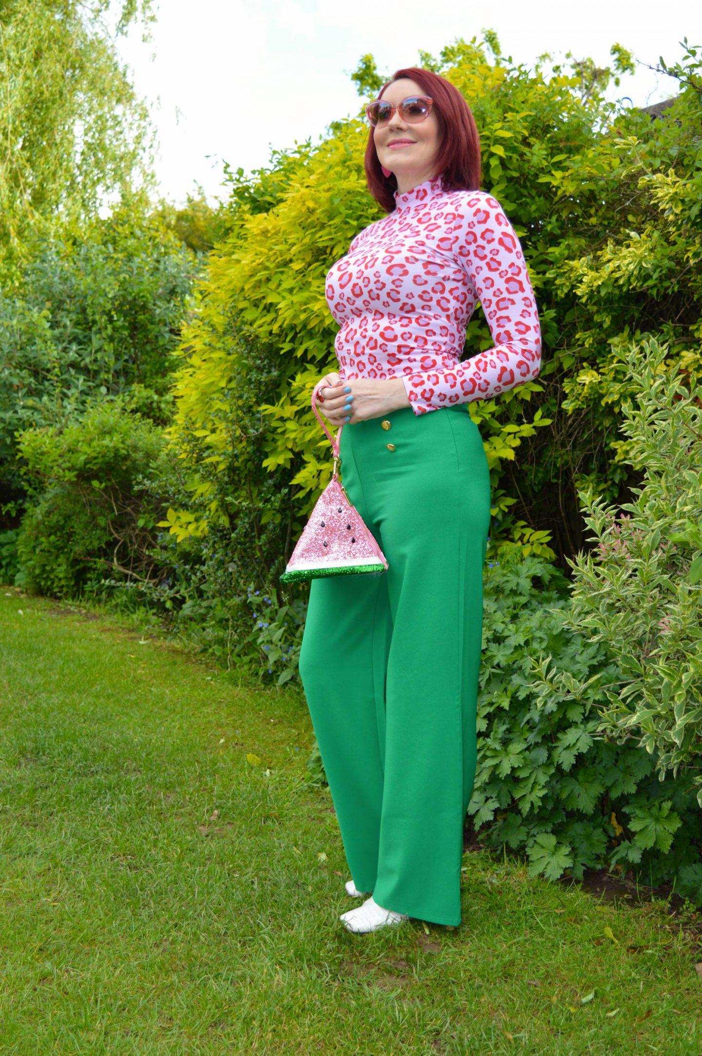 Green and Pink Animal Print, Saturday by Megan Ellaby Hazel pink animal print top, Skinny Dip glitter warermelon bag, Flounce emerald green trousers