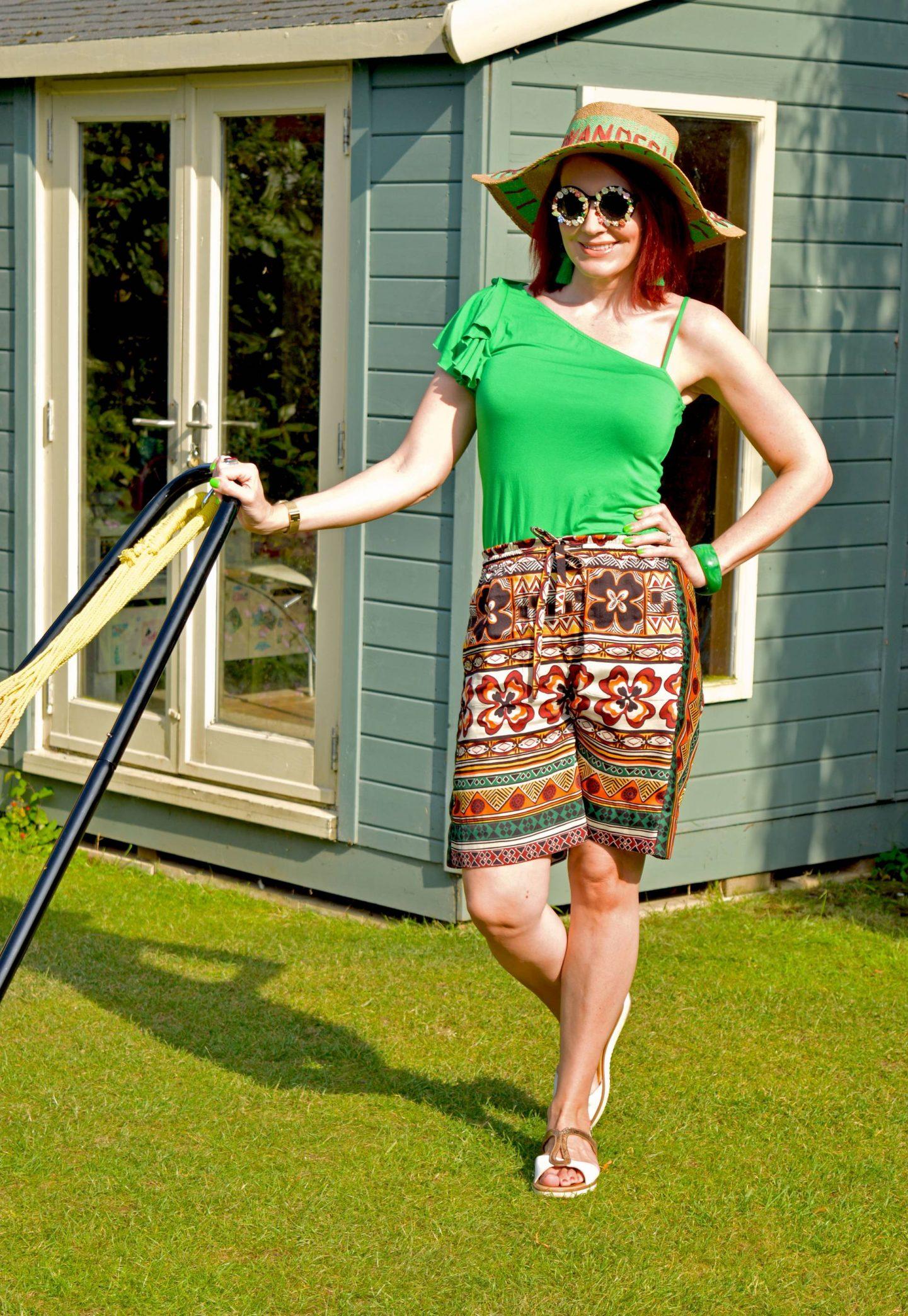 Karen Millen green one shoulder top, Zara print bermuda shorts