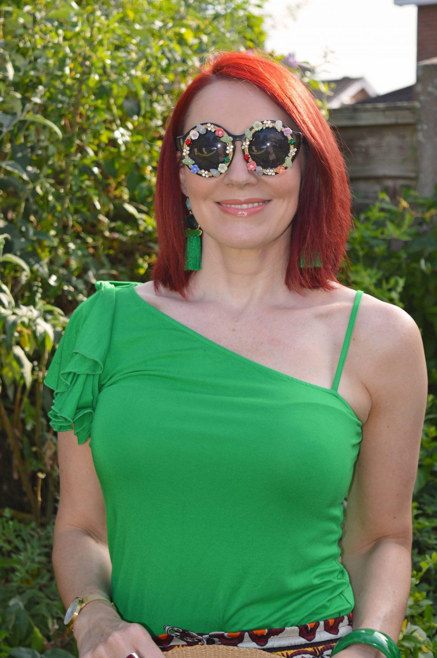Karen Millen green one shoulder top, Katy Perry embellished sunglasses