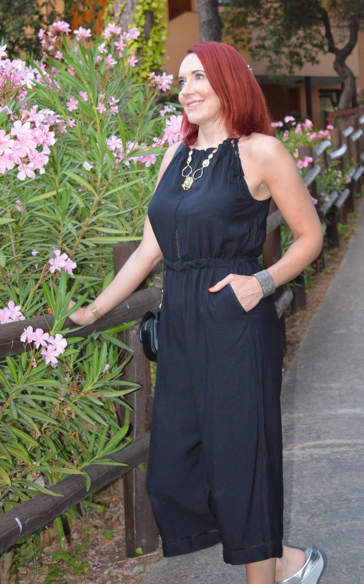 A Beach Jumpsuit Styled For Evening, Seafolly black beach jumpsuit, Zara black quilted crossbody bag, silver glitter FitFlops, Oliver Bonas gold lion necklace