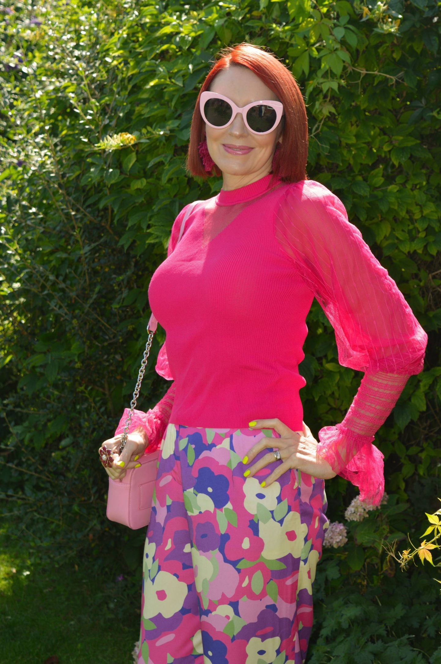 Styling Our Statement Sleeves - August's Style Not Age, River Island pink sheer sleeve top, Monki purple print trousers, River Island pink cat eye sunglasses, Nali pink camera bag