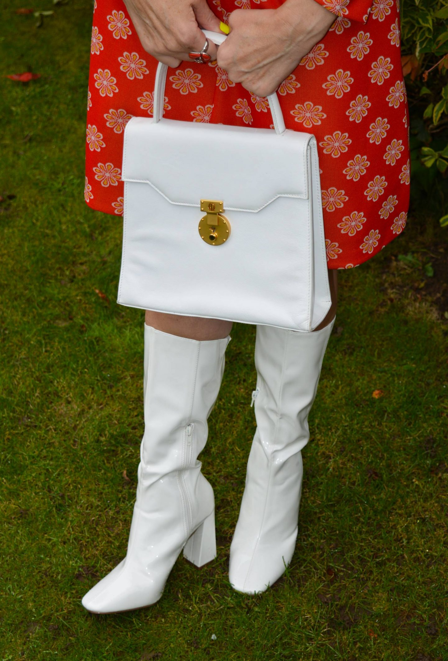 long white boots, white top handle bag